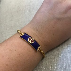 Gucci charm bracelet gold blue and red